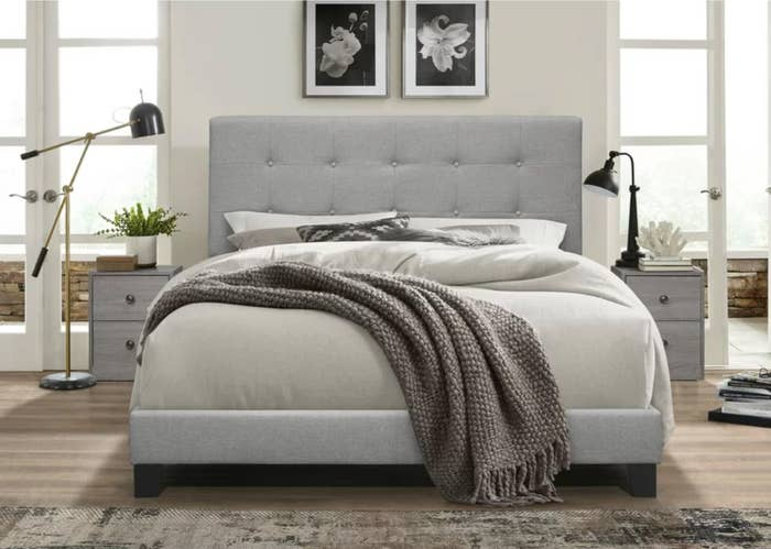 The three-piece upholstered bedroom set in gray