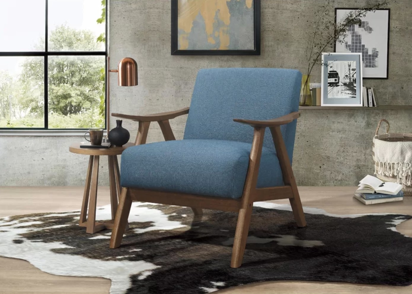 The mid-century armchair in blue polyester
