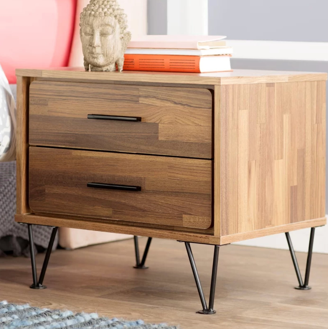 The two-drawer nightstand in walnut wood with metal legs
