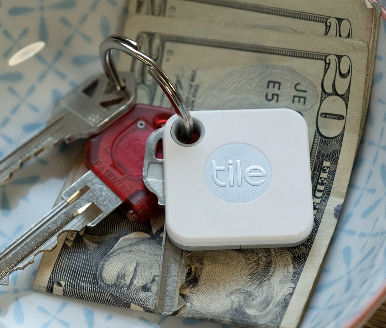 A white square Tile Mate attached to a key ring