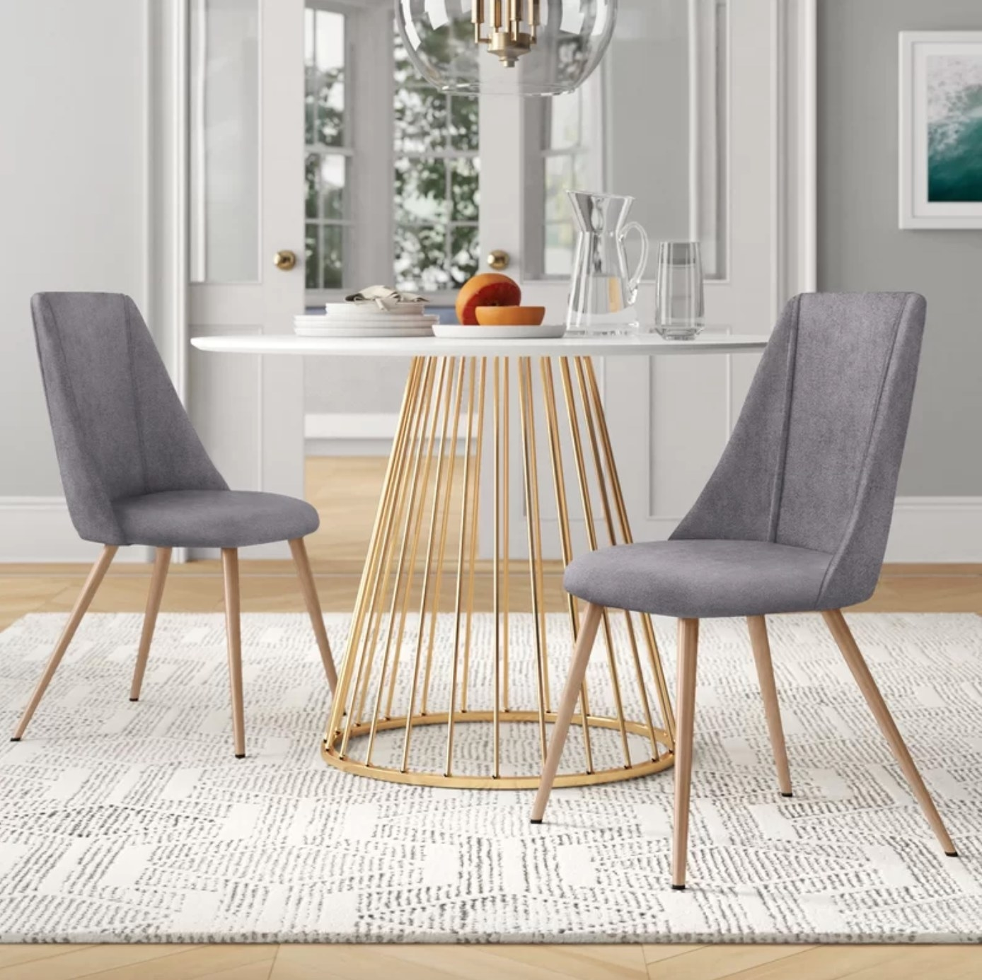 The set of two upholstered chairs in grey