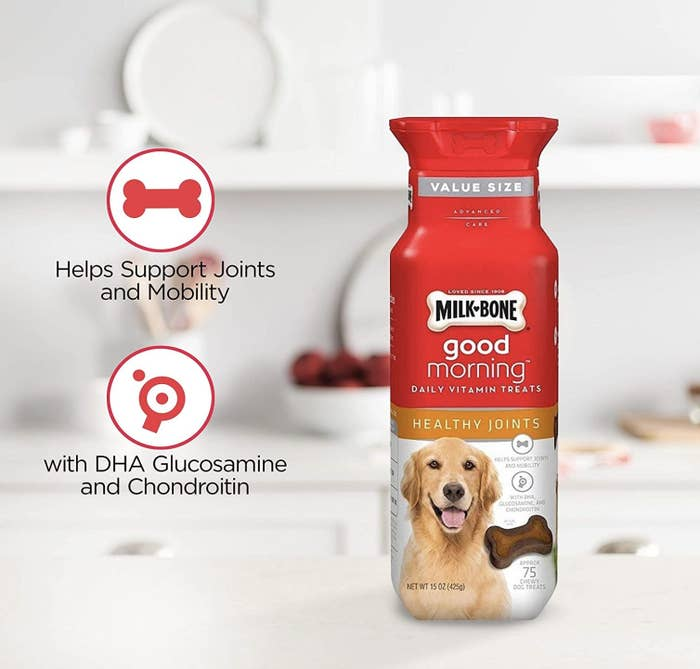a red and white bottle of dog vitamins on a kitchen counter