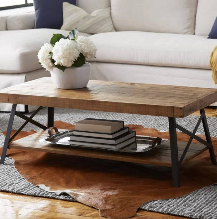 The wood coffee table with storage and metal legs