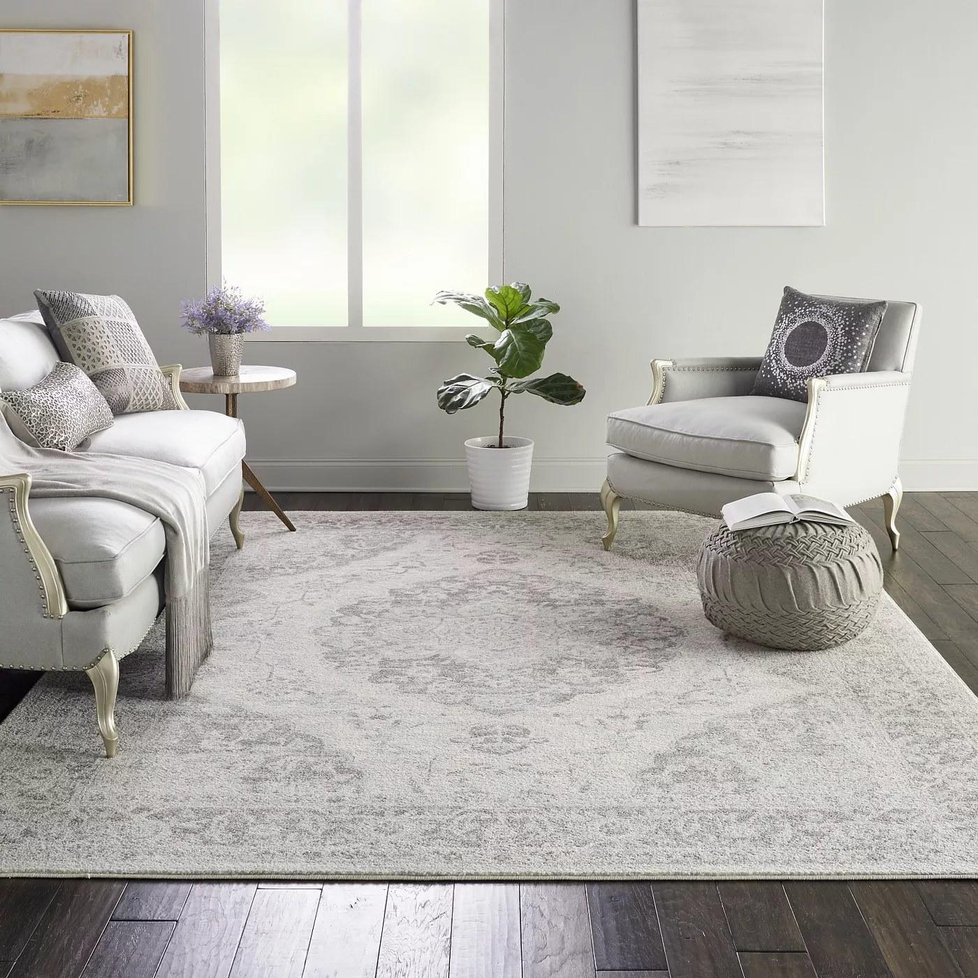 The light gray, medallion rug