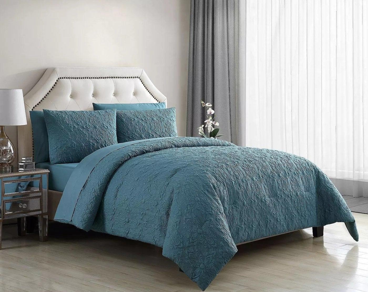 The greenish-blue, embossed quilt set