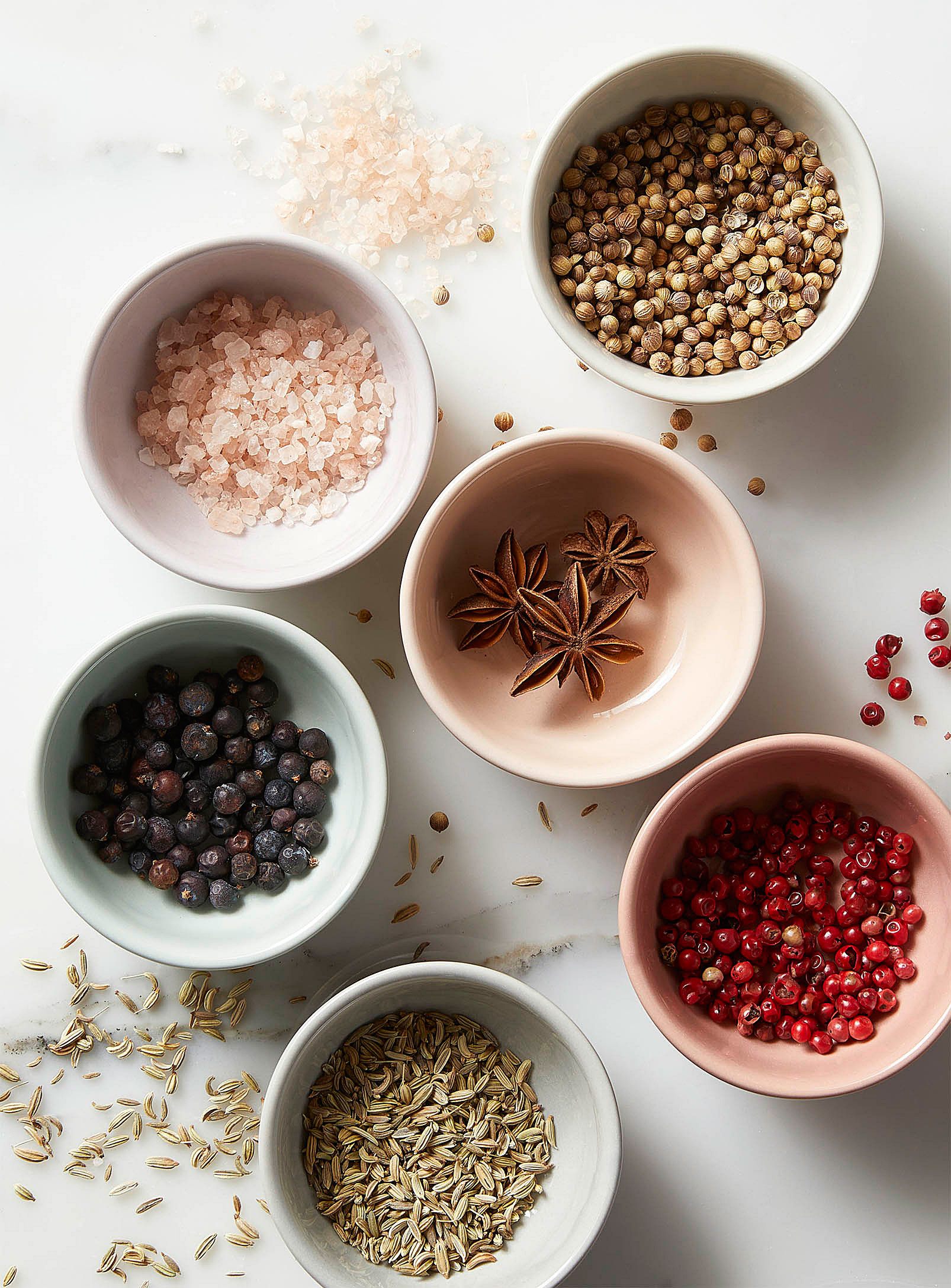 A set of six bowls filled with different ingredients on a counter