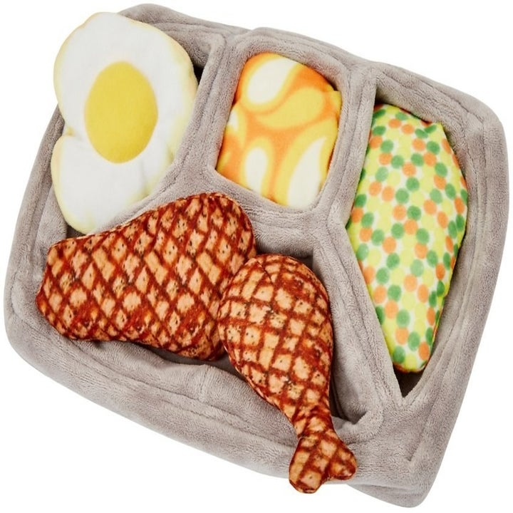 Plus Dinner tray with two pieces of chicken, an egg, mashed potatoes, and carrots with peas – all removable