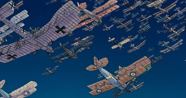 A huge amount of biplanes in a clear blue sky