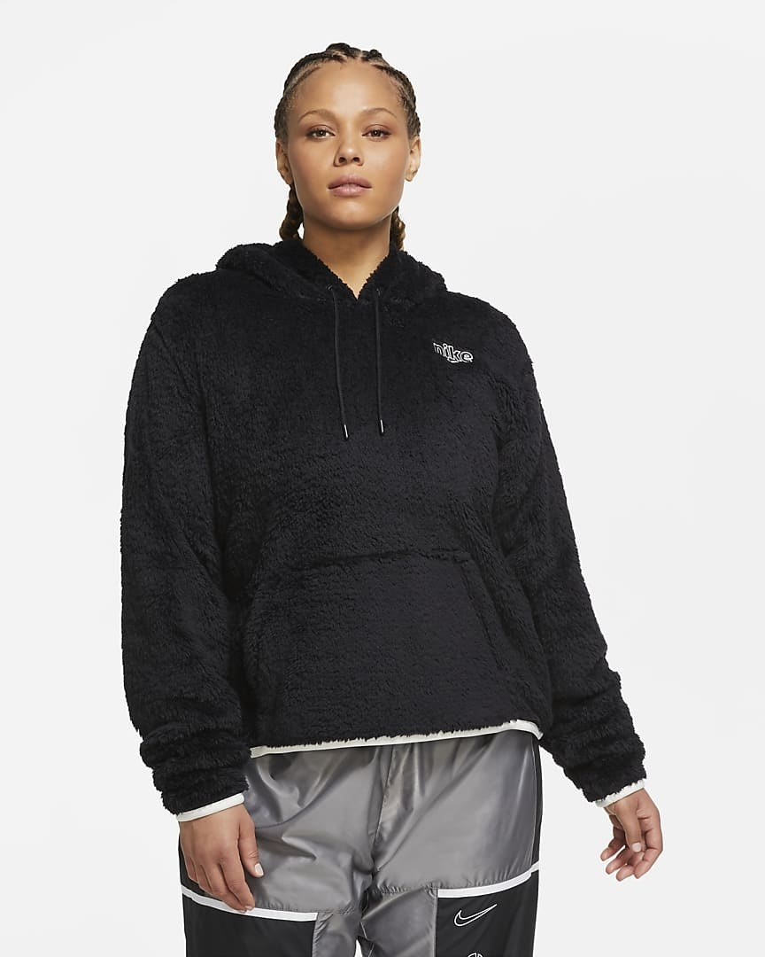A plus size model wears the sportswear hoodie in black