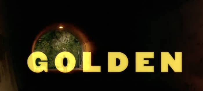 The word 'golden' is written out in golden letters in front of a tunnel