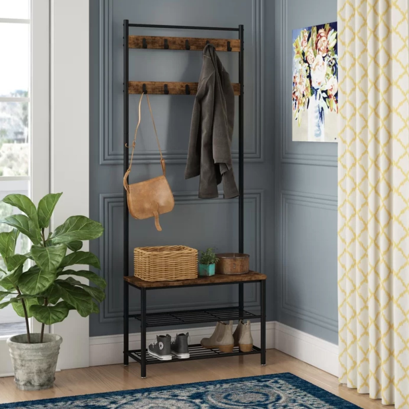 The hall tree with shoe storage, a bench, and coat hooks