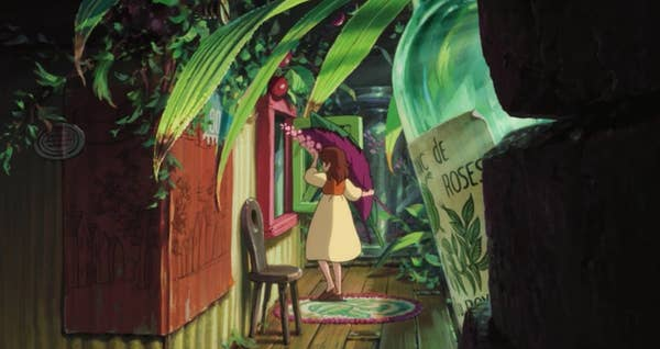 A girl in a lushly decorated hallway