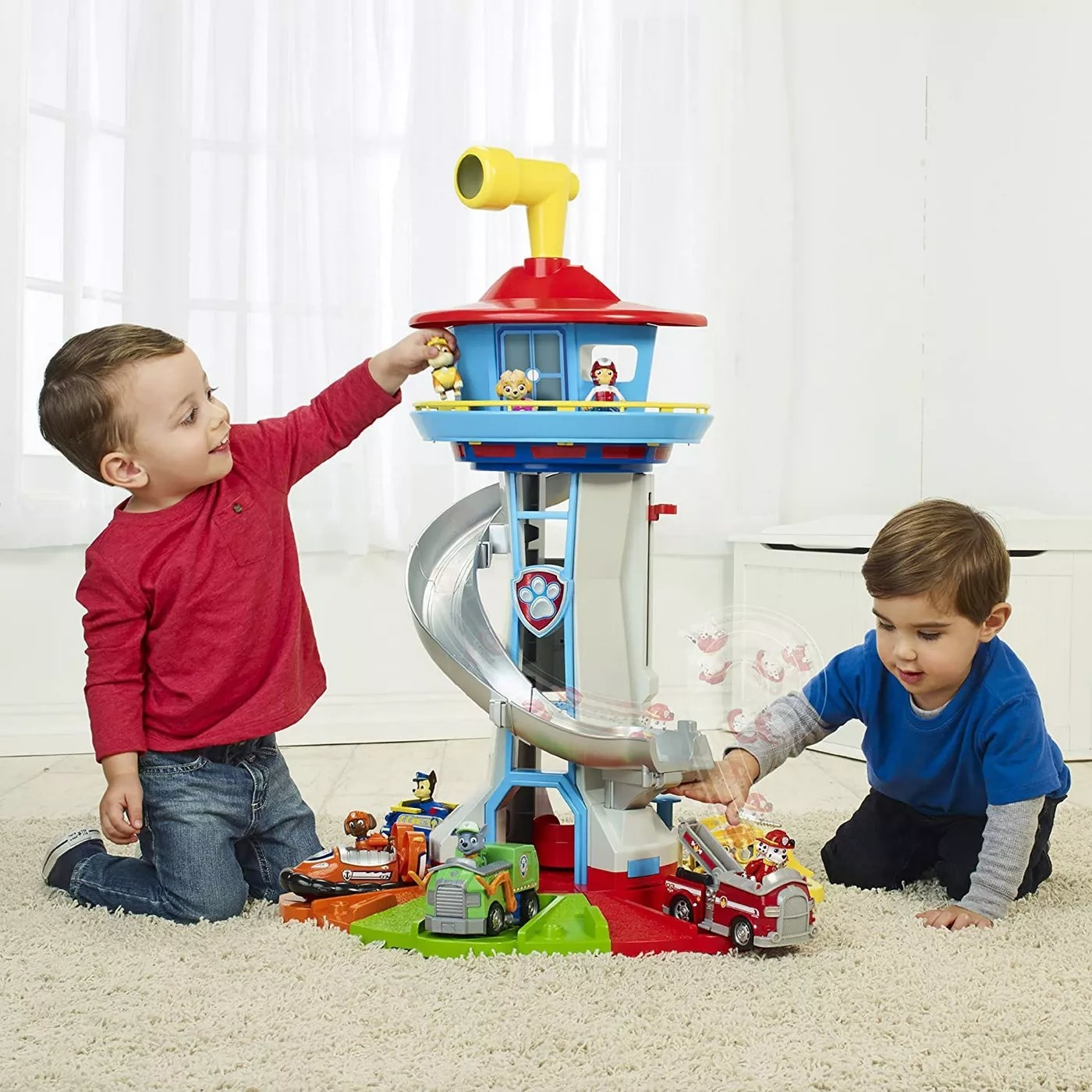 Two toddlers playing with the tower