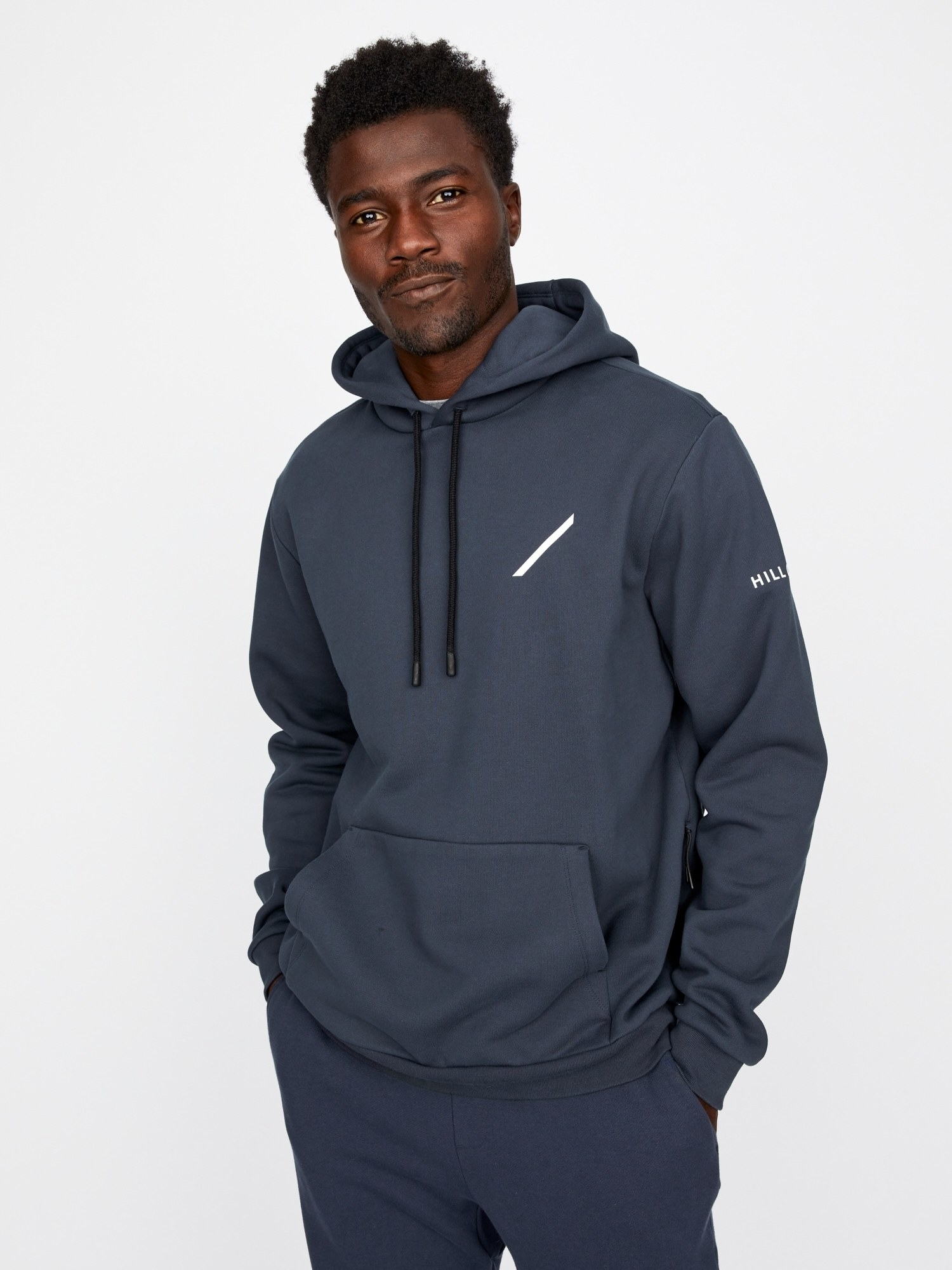 Model wearing the hooded sweatshirt with a white line across the left side of the chest and logo on the arm in blue with black drawstring