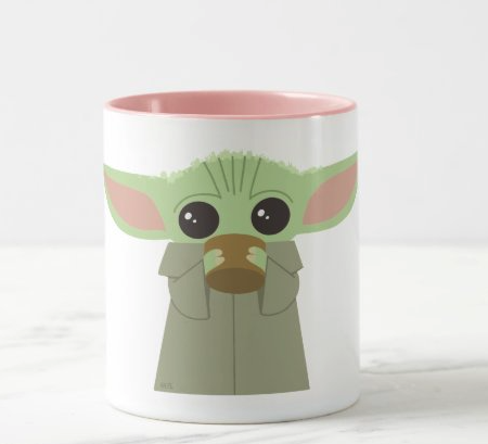 baby yoda sipping out of a cup on a mug