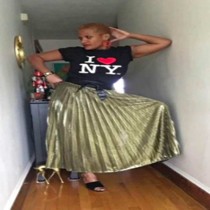 reviewer wearing the skirt in gold