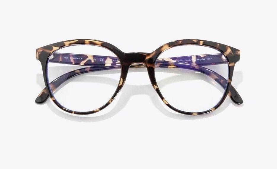 the tortoiseshell glasses