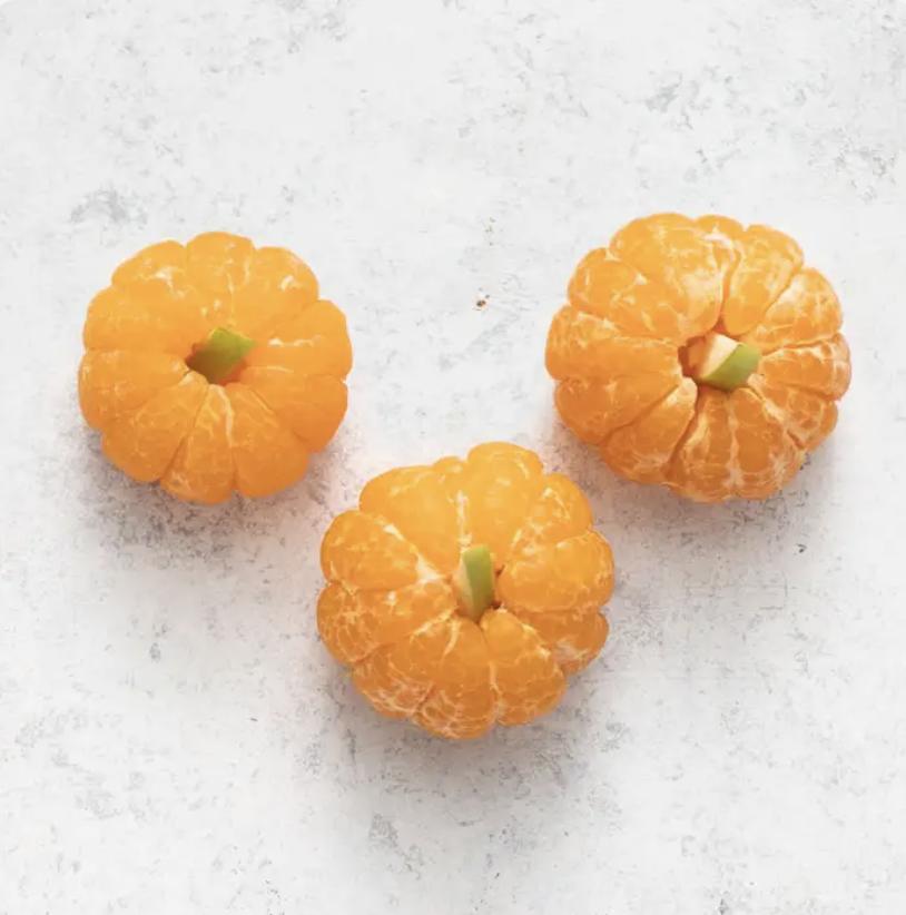 Three clementine pumpkins