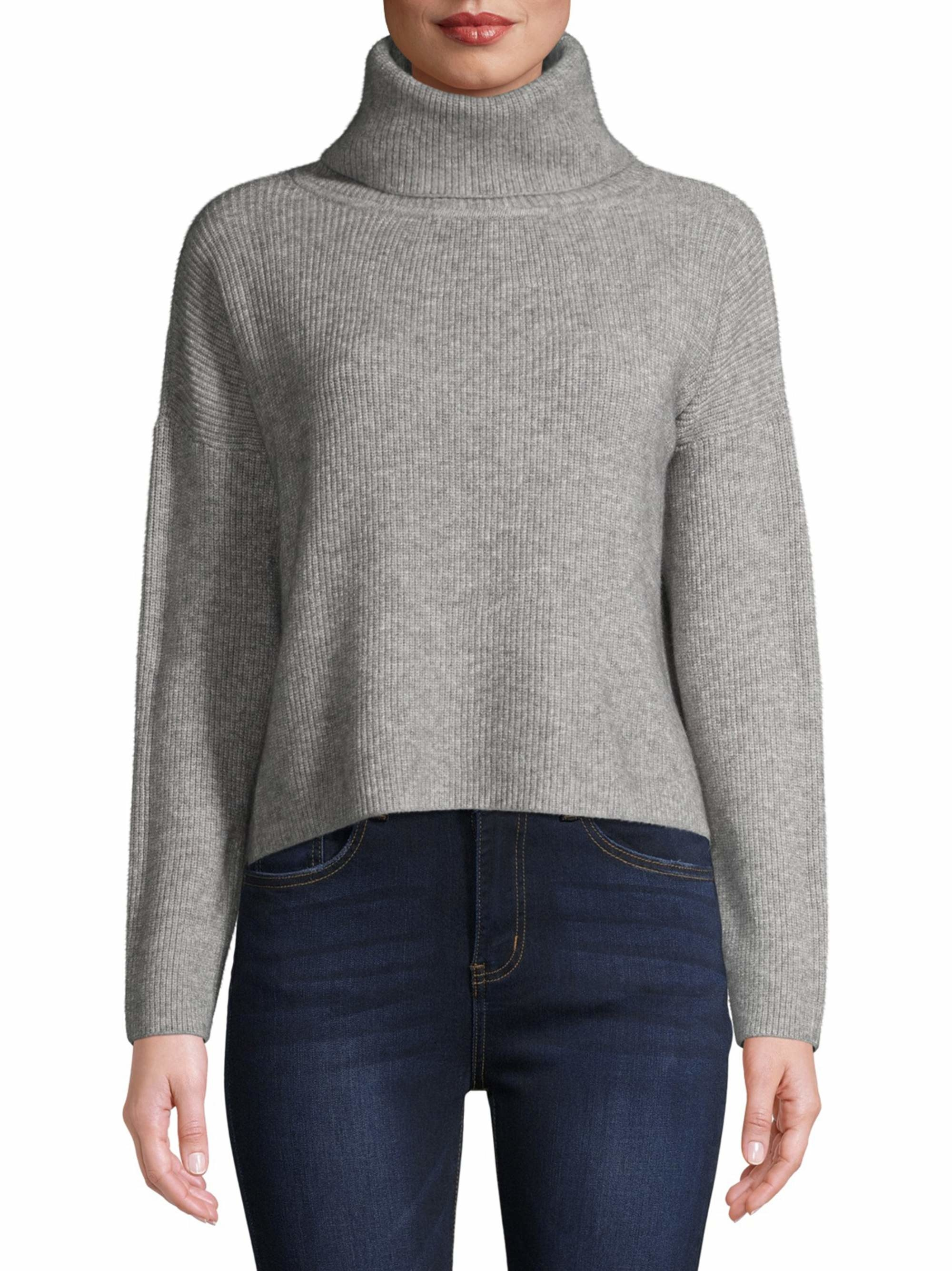 Model wearing grey cowl neck sweater and jeans