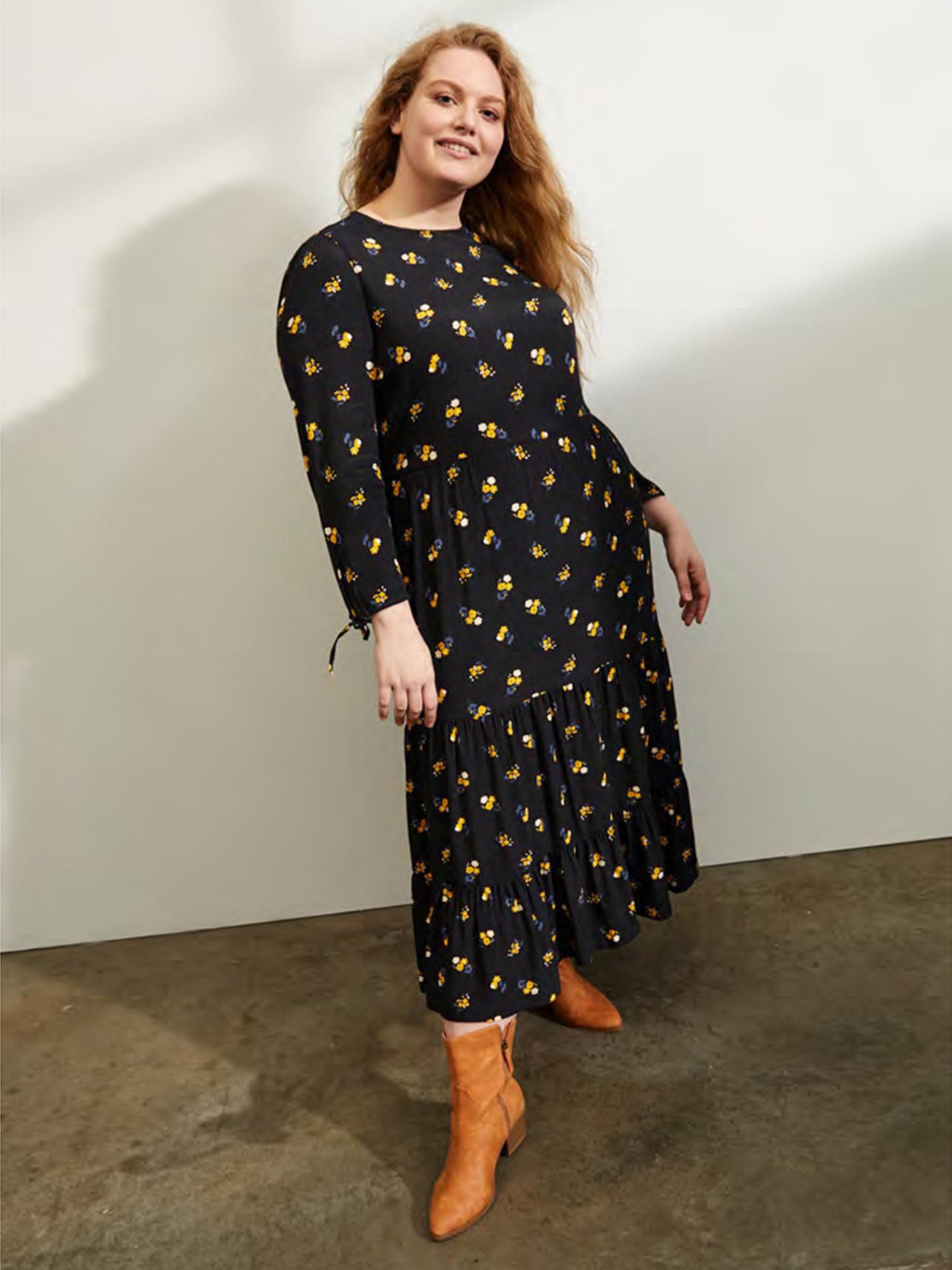 Model wearing tiered maxi dress