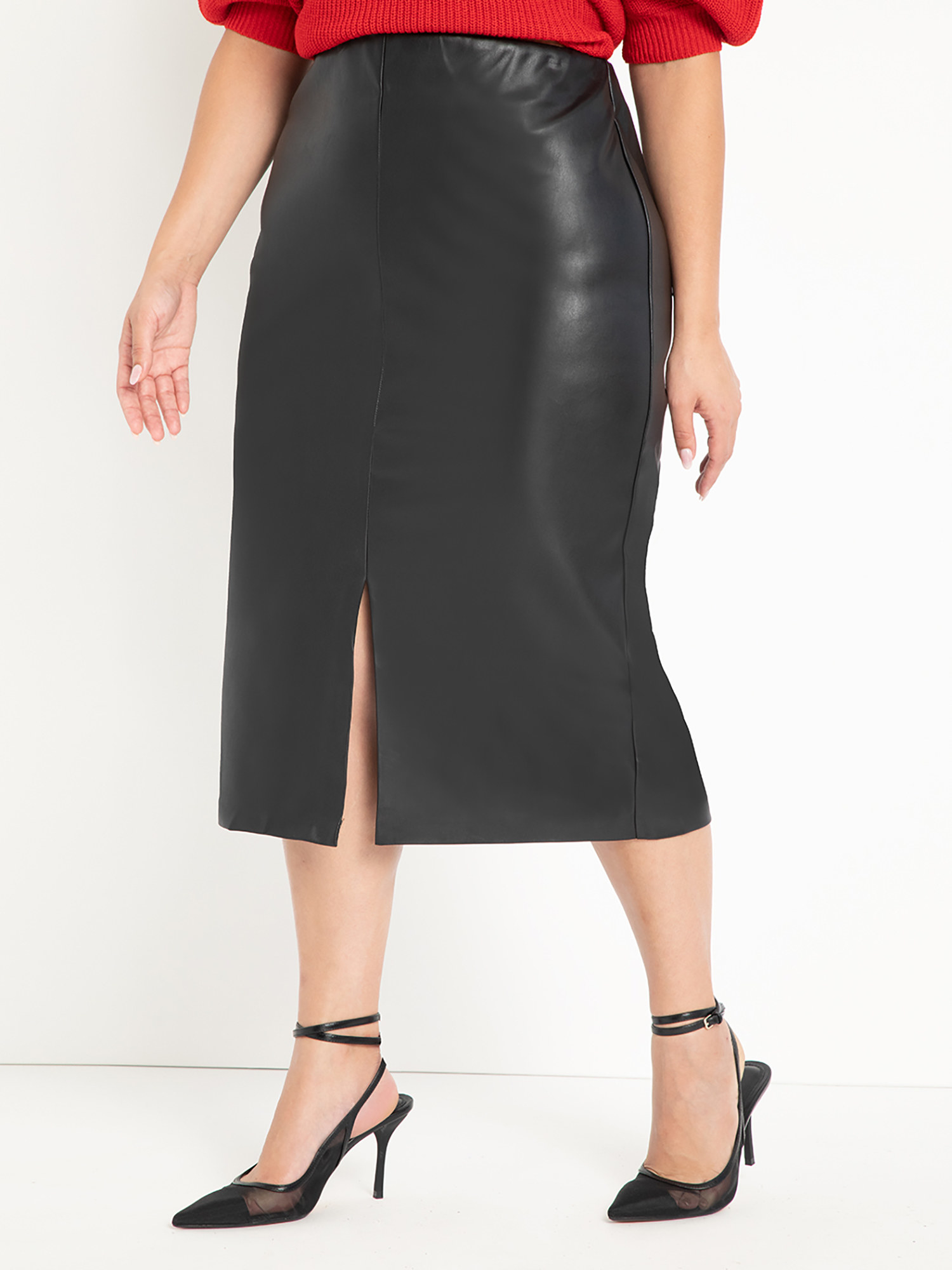 Model wearing faux leather skirt and kitten heels