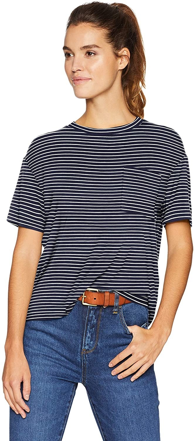 model wearing the black and white striped t-shirt