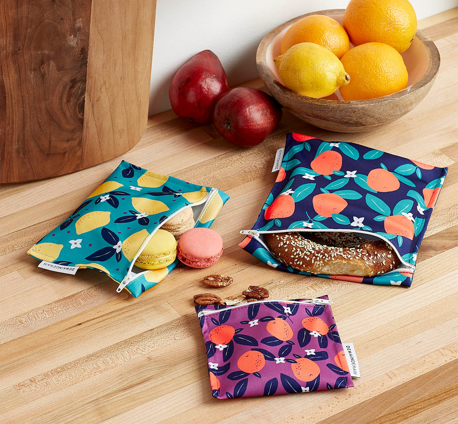 Three fabric food bags of different colours and sizes