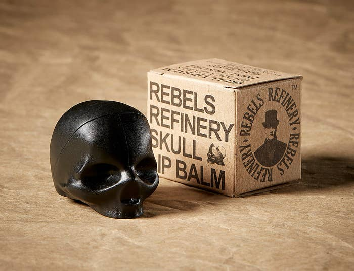 A skull-shaped lip balm next to the box it came in