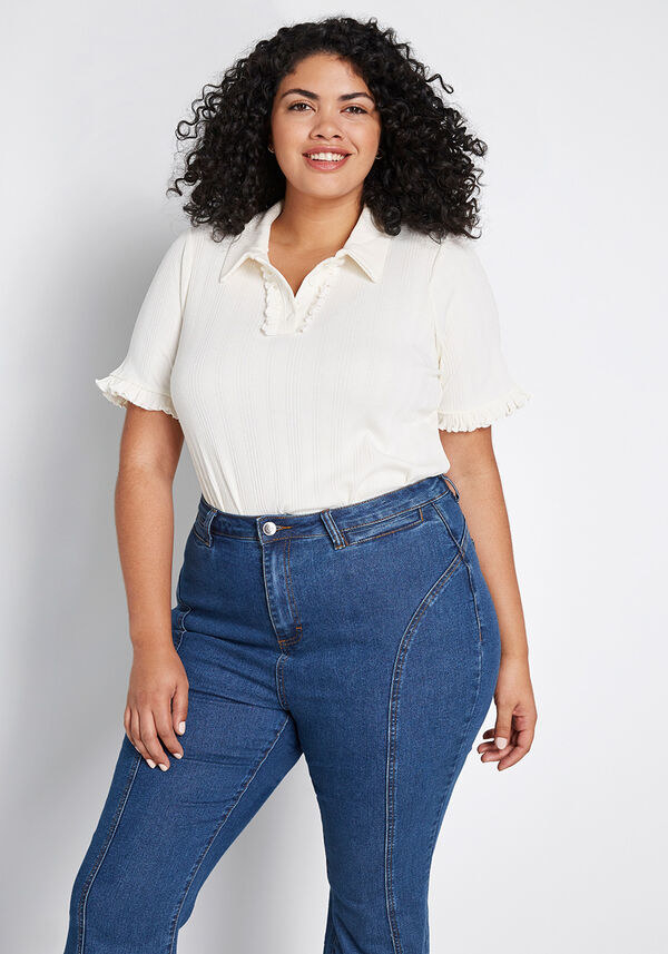 plus size model wearing the polo with jeans