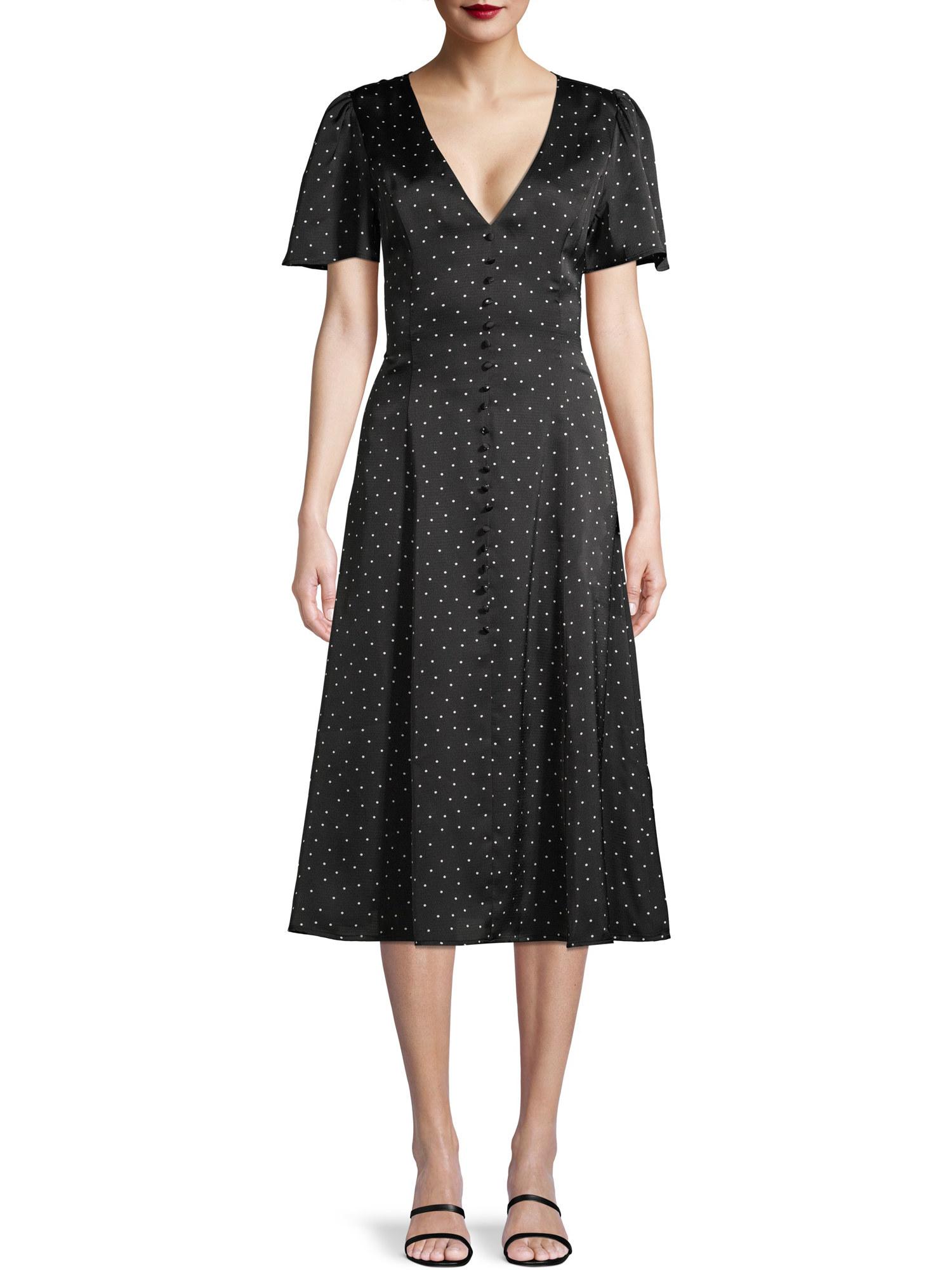 Model wearing polka dot dress