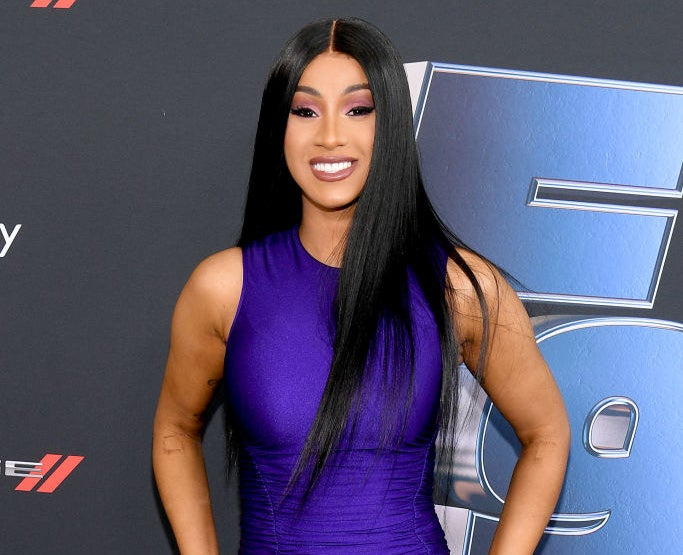 Cardi B smiling on the red carpet