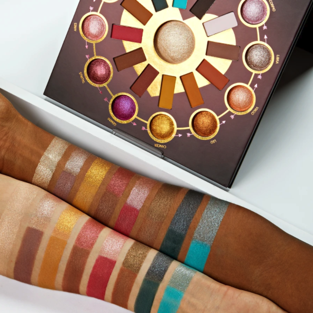 the zodiac palette and swatches on two different arms