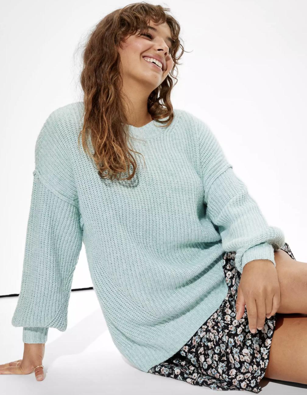 a model in an oversized light blue sweater