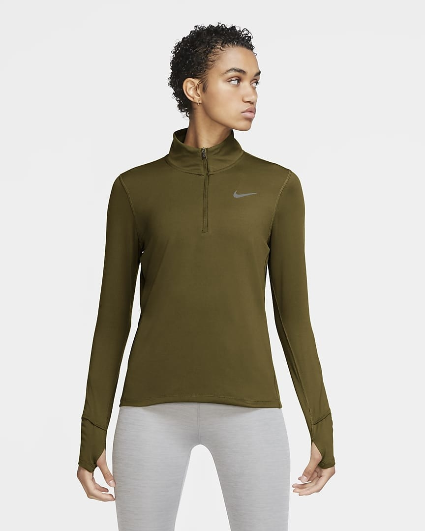 A model wearing the nike element running top in olive flak