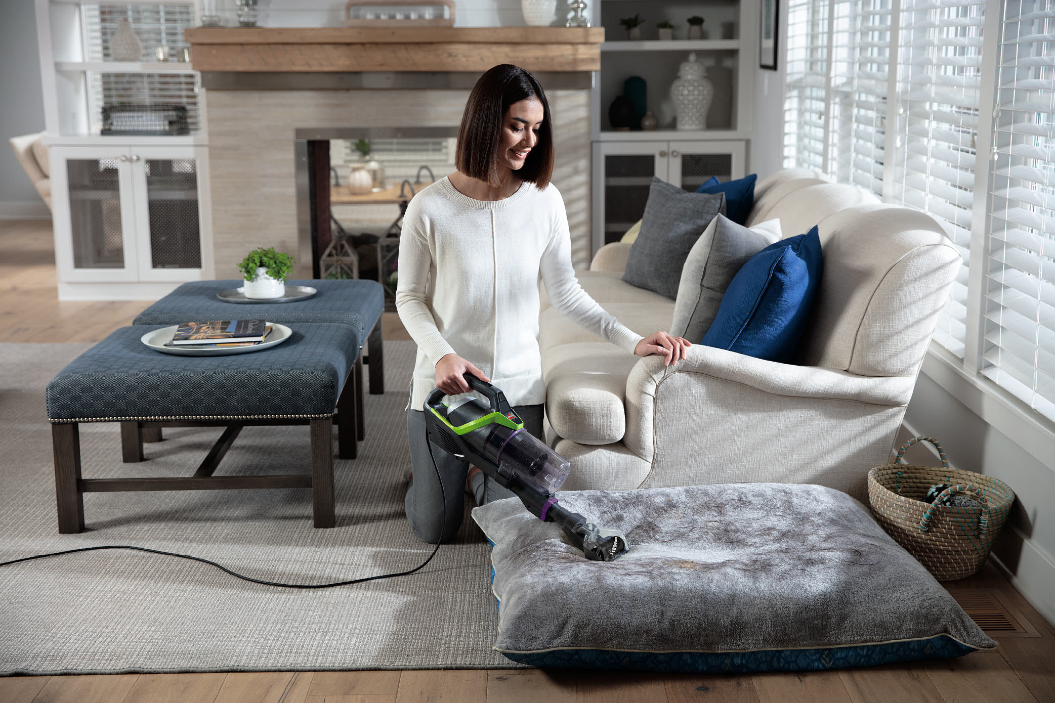 A model using the vacuum on a pet bed