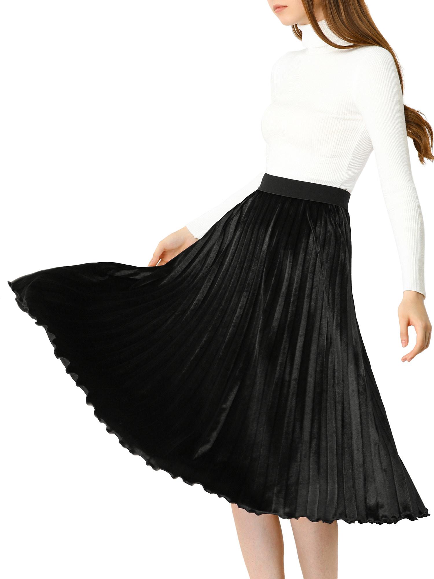 Model wearing pleated black skirt