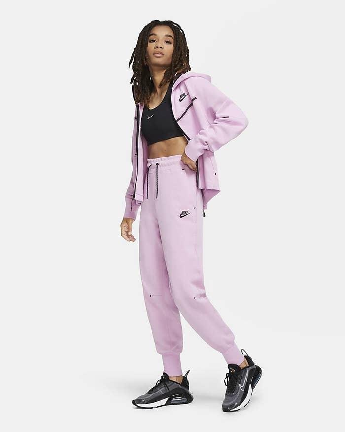 A model wears a full sportswear tech fleece jogging suit