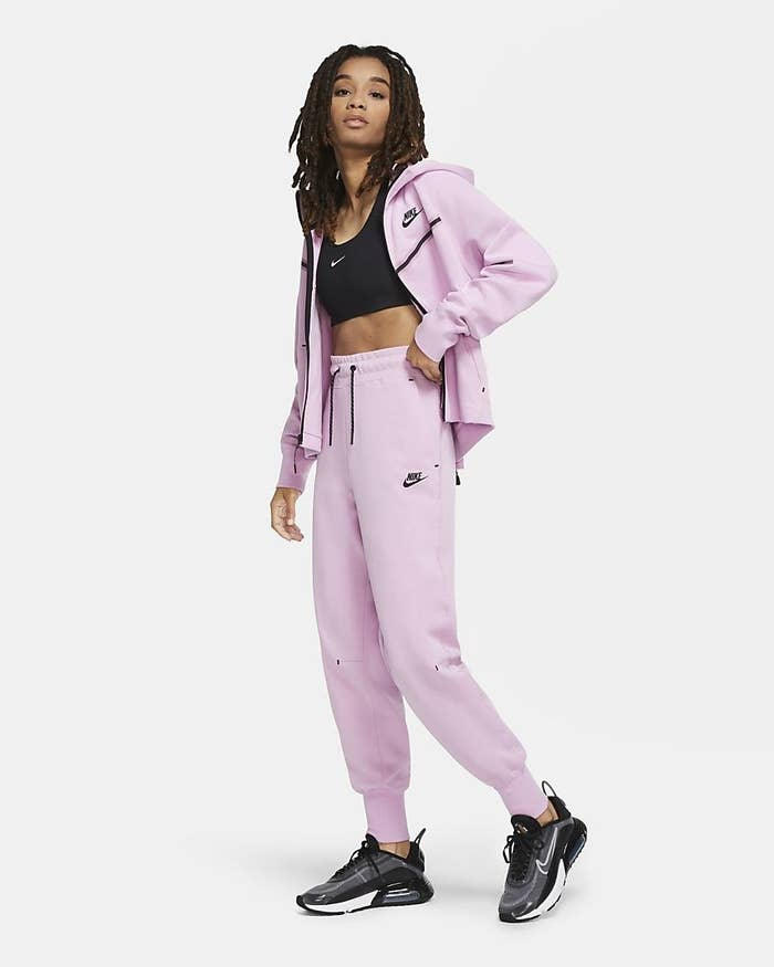 A model wears a full sportswear tech fleece jogging suit