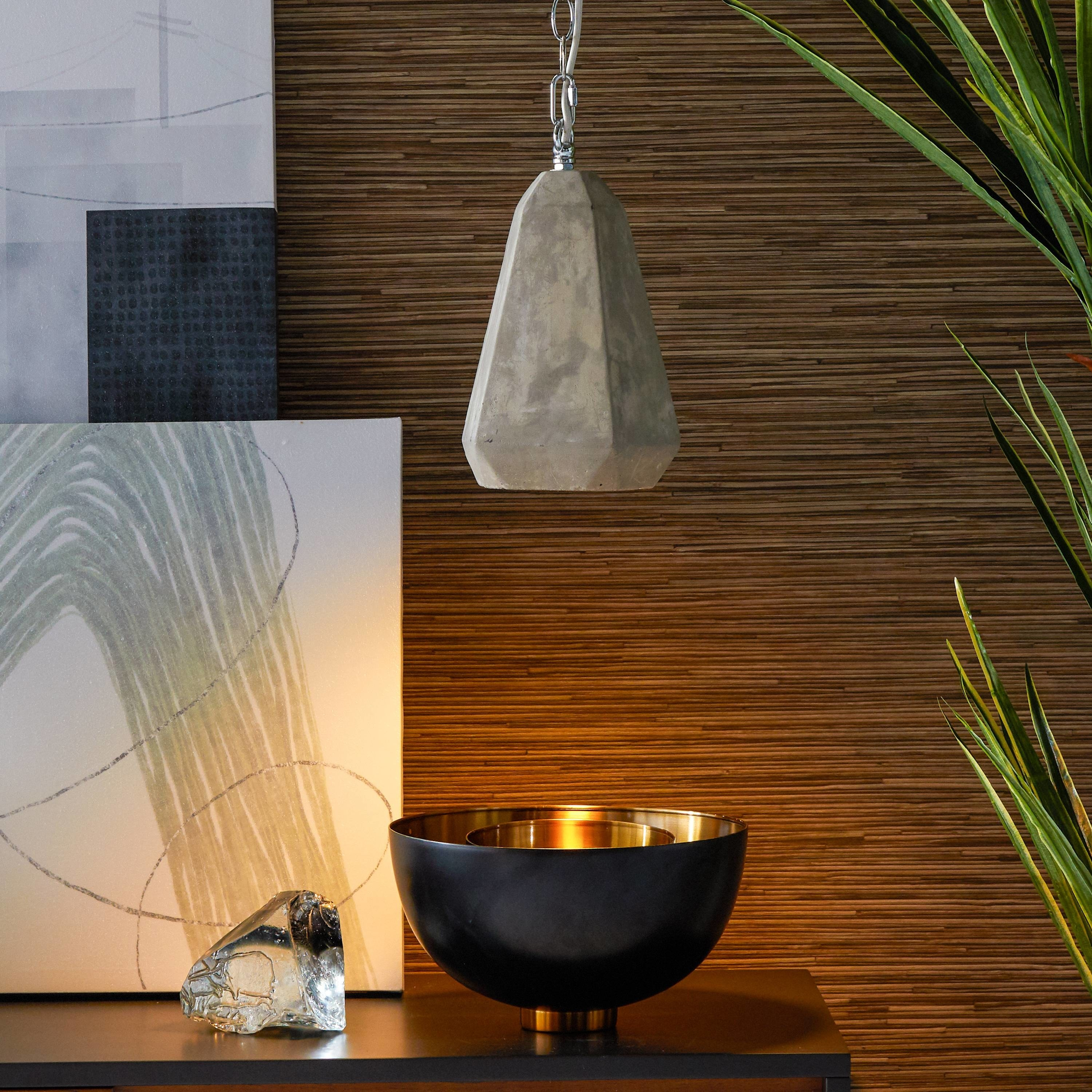The lamp hanging above a bronze bowl