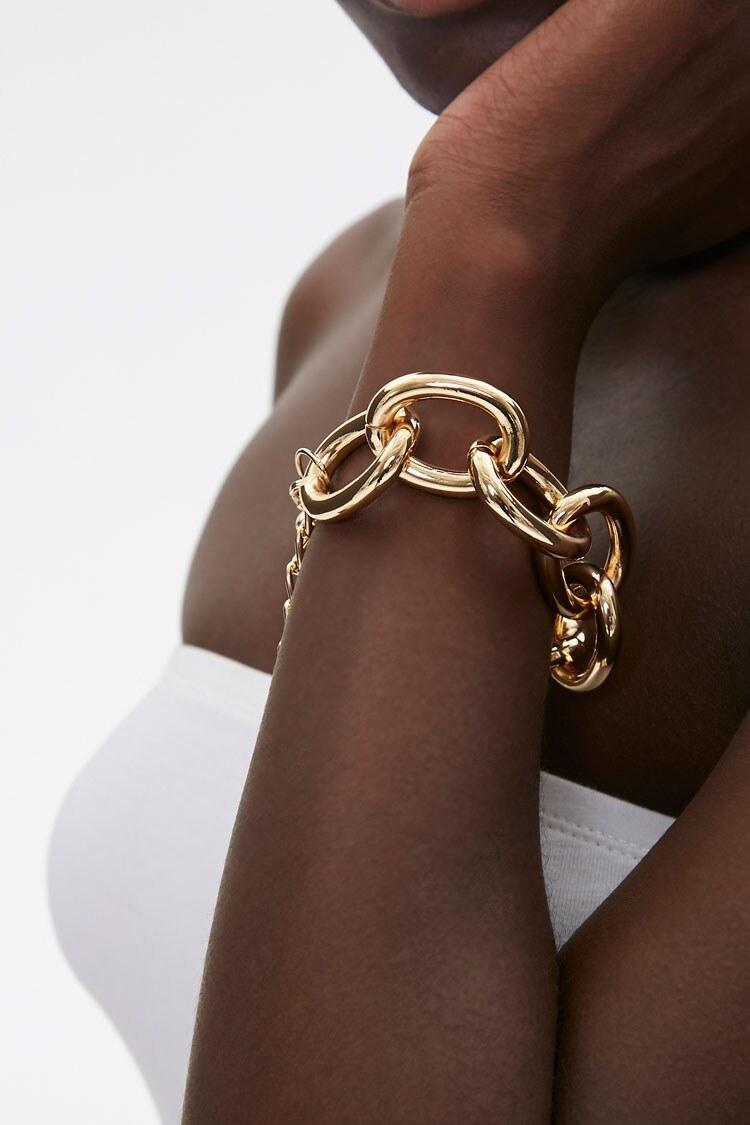 model wearing the gold bracelet