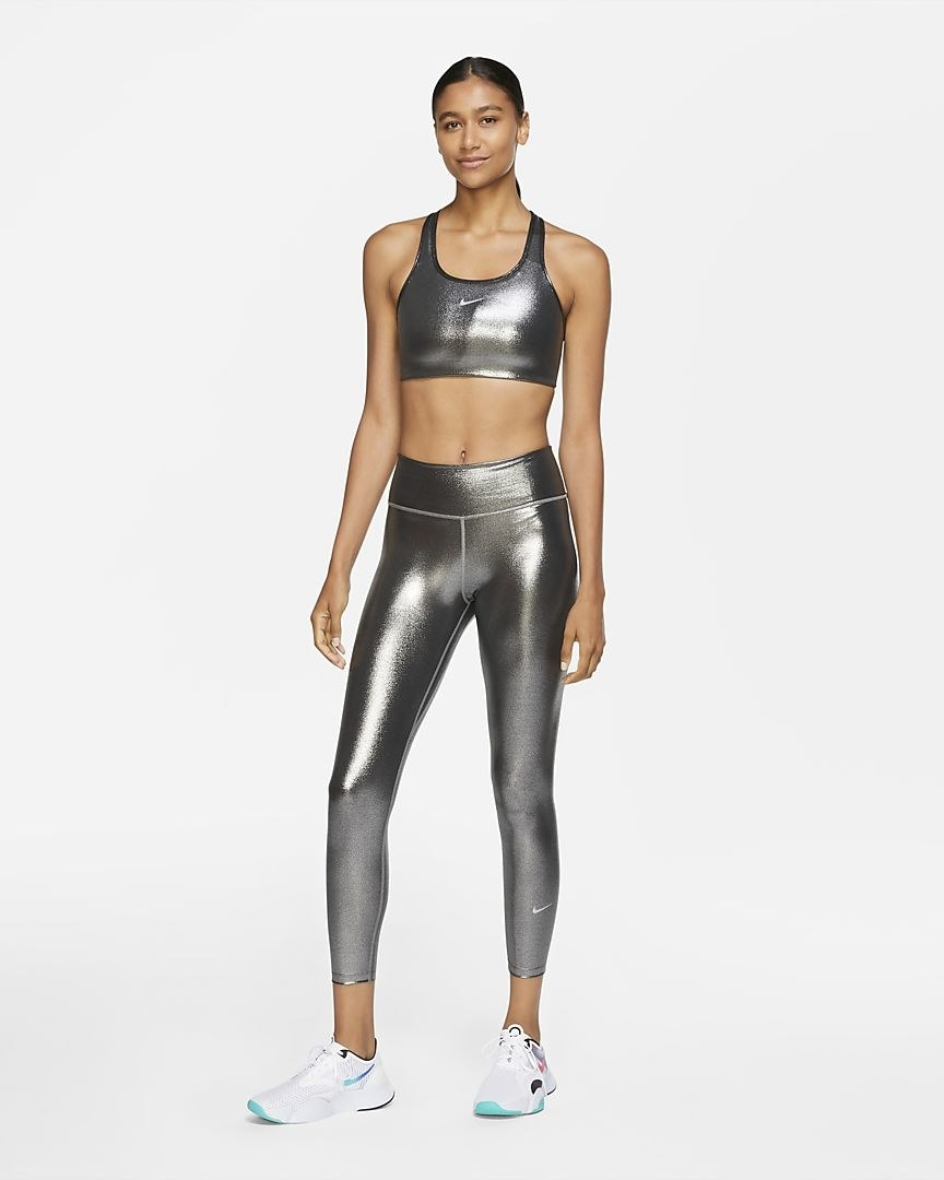 A model wearing the Nike One Icon Clash leggings in metallic silver