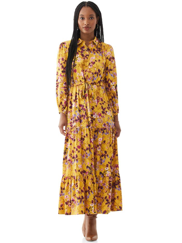 Model wearing yellow maxi floral dress
