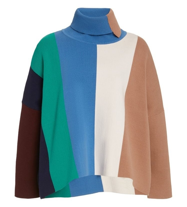 a flowy sweater with vertical sections of brown, blue, green, white, and tan colors