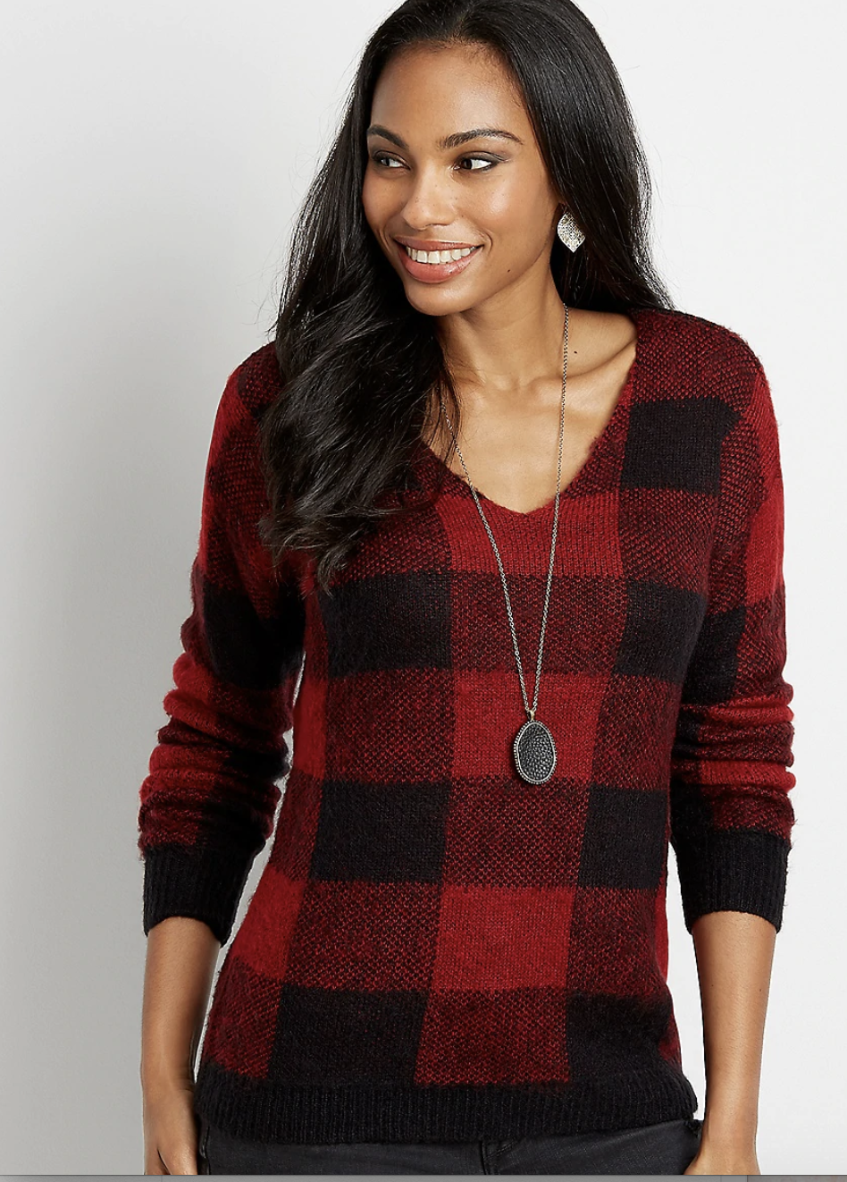 a model in the red and black sweater