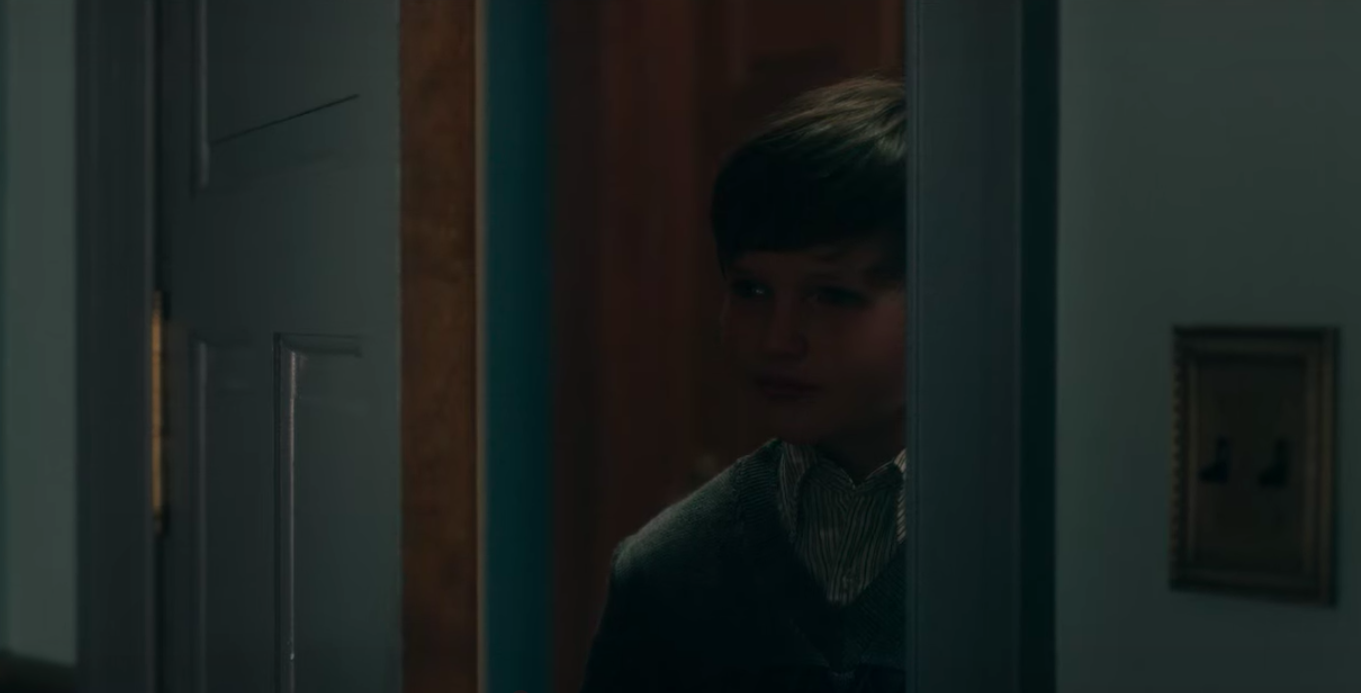 Benjamin Evan Ainsworth as Miles looks through a doorway