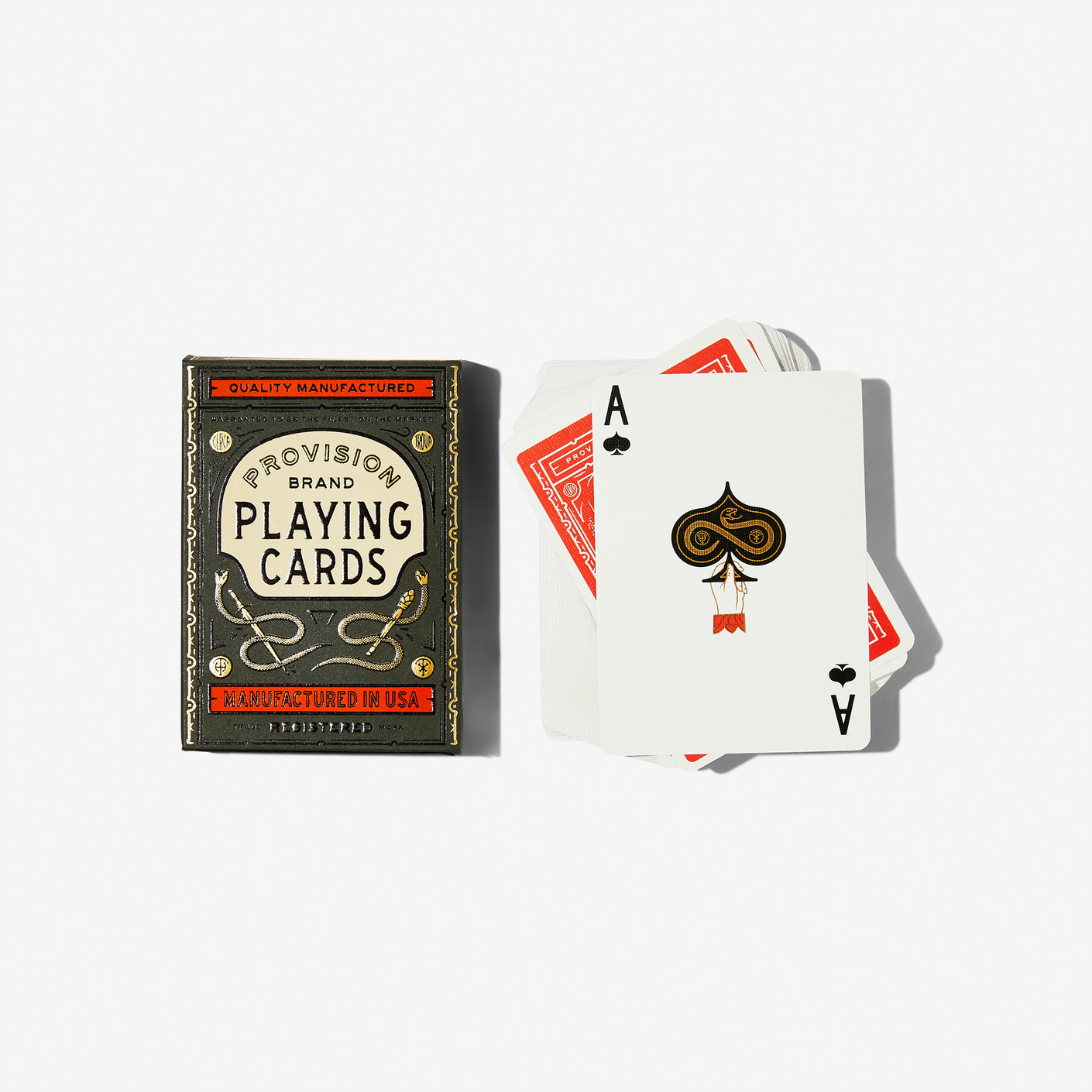 provision brand playing cards with snakes on the pack and the ace of spades showing with a hand holding up a spade with a snake on it