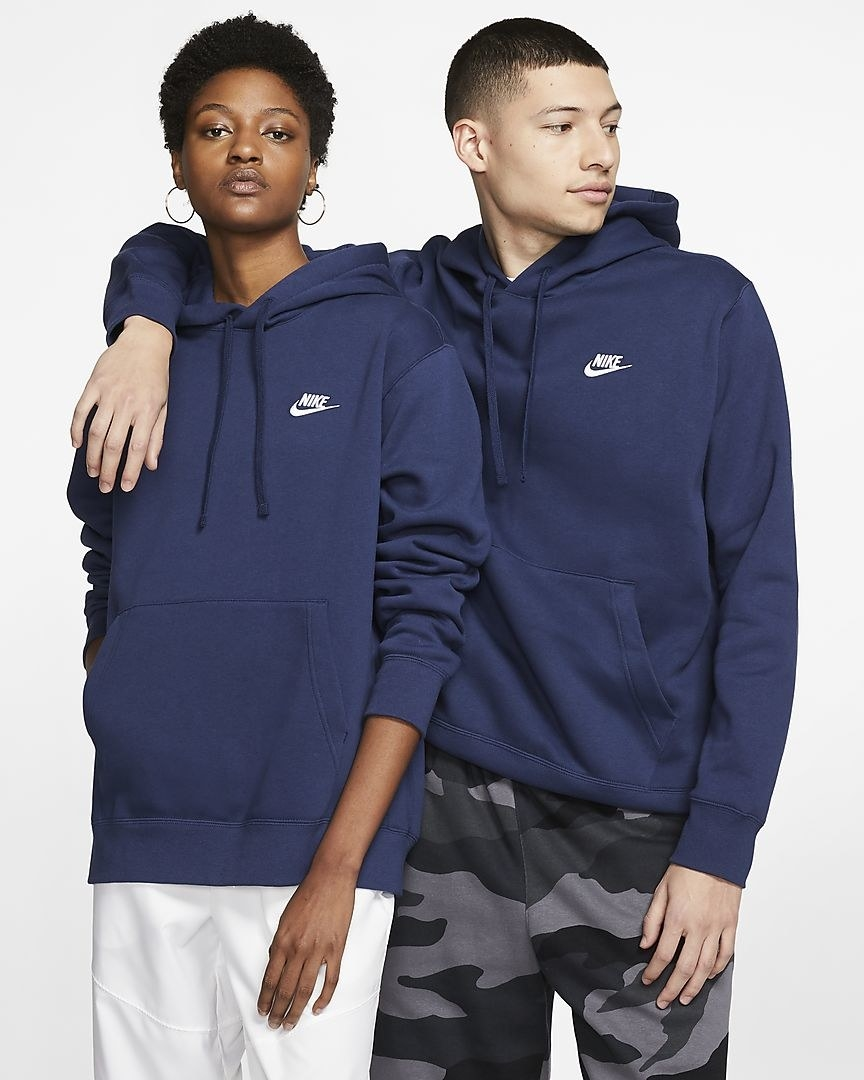 Two models wearing the hoodie standing next to each other