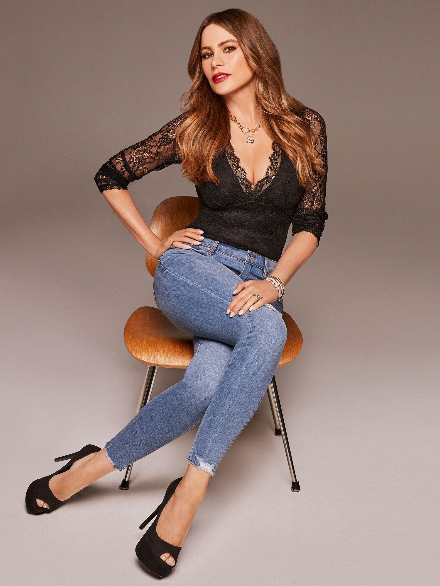 Sofia Vergara wearing lace bodysuit with jeans