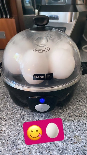 BuzzFeed Editor Samantha Wieder's black rapid egg cooker cooking six hard boiled eggs at a time