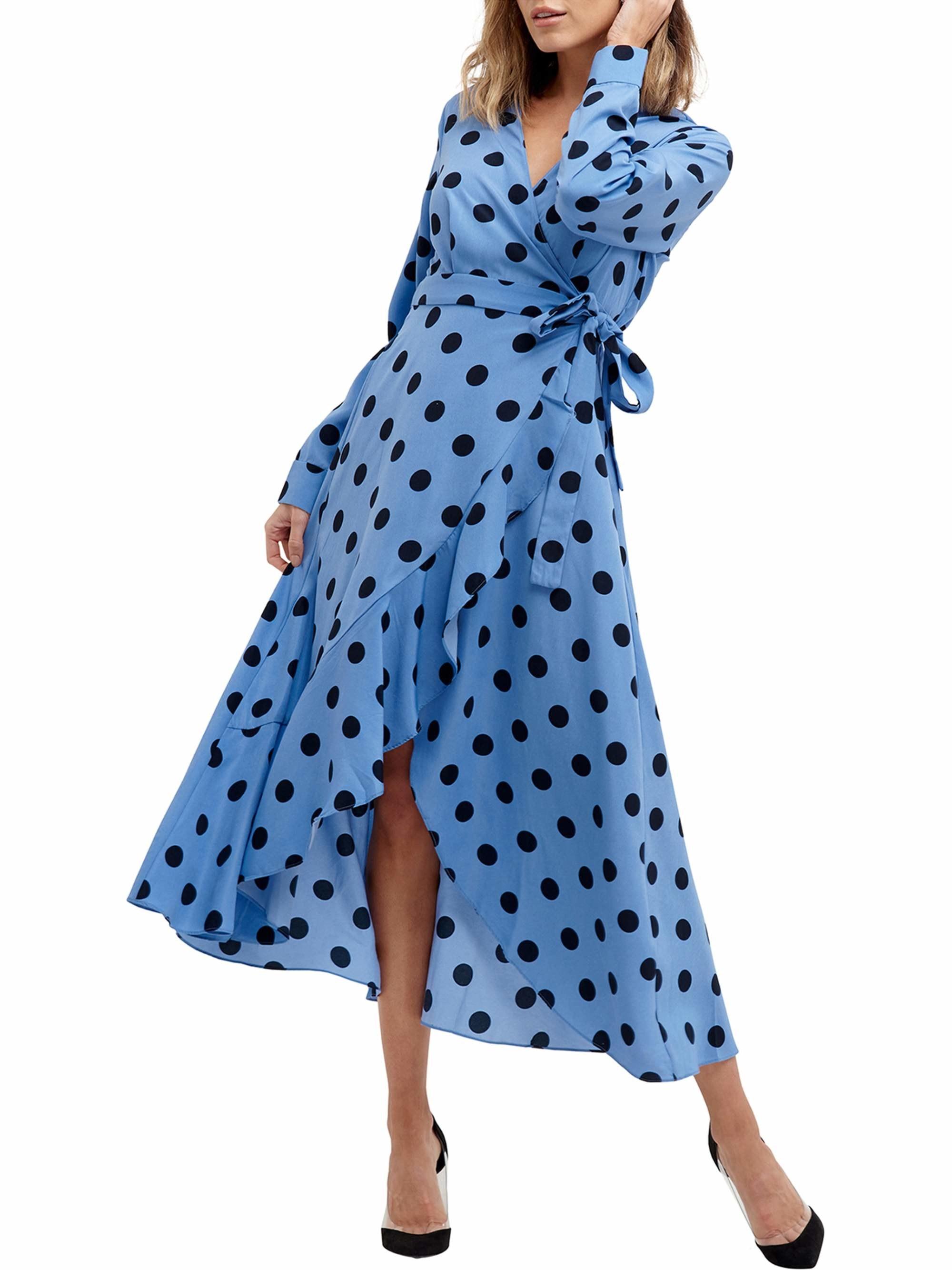 Model wearing blue polka dot dress